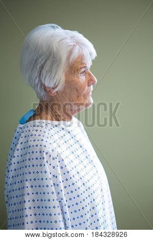 Close-up of senior patient standing at hospital