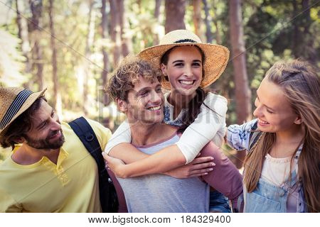 Smiling friends having fun in park on a sunny day