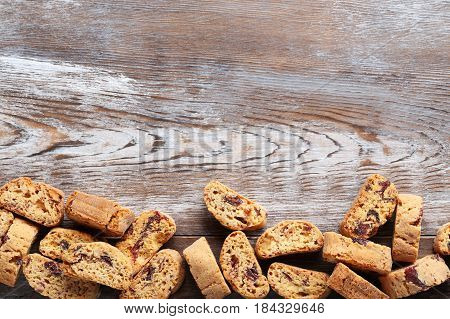 Cantuccini cookies on brown wooden table, close up