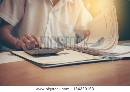 Business analysis - calculator sheet graphs (business report) and analyst hand