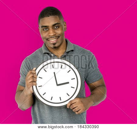 African Descent Man Holding Clock