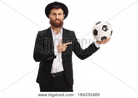 Bearded guy holding a football and pointing isolated on white background