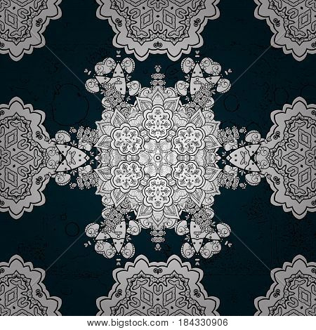 Pattern on blue background with white elements. Blue tree with gray trim. Element woodcarving. Furniture in classic style. Small depth of field. Patina. Luxury furniture. Carving.