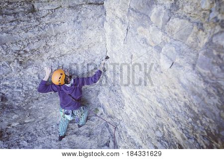 Rock Climber Reaching For His Next Hand Hold, Joshua Tree National Park.