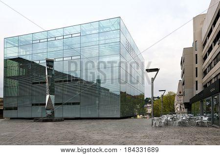 Stuttgart, Germany - April 17, 2017: Glass cubic modern building of the Museum of Art in Stuttgart.