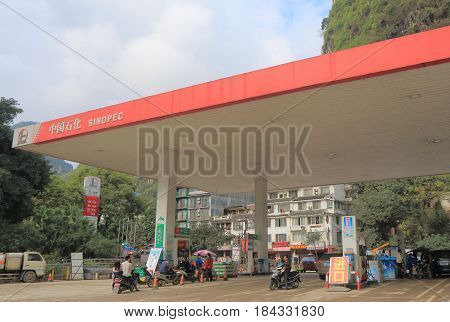 YANGSHOU CHINA - NOVEMBER 19, 2016: Unidentified people buy gasoline at Sinopec gas station. Sinopec is one of the major state-owned petroleum energy and chemicals companies in China.