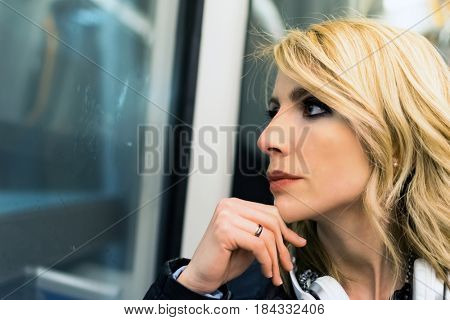 Woman in a subway train