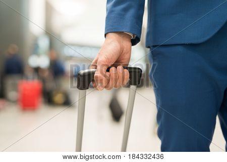 Detail of a traveler pushing his trolley