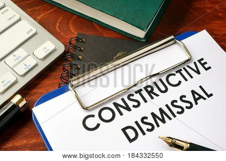 Constructive dismissal on a clipboard. Termination of employment concept.