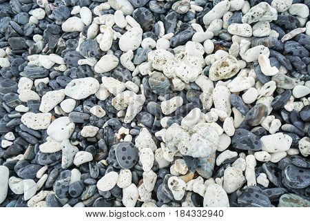 close up texture of white and grey round stones