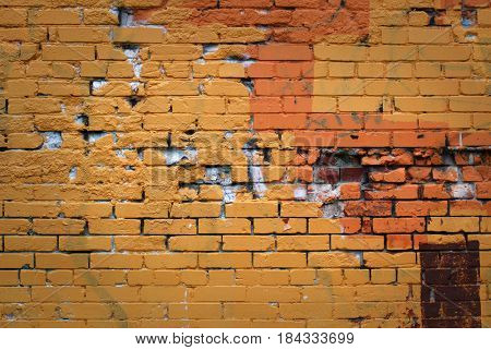 Old brick wall, colorful and damaged background of brick wall