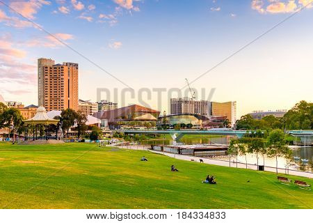 Adelaide Australia - April 5 2017: Adelaide city skyline with Torrens river foot bridge at sunset viewed from King William street towards west.