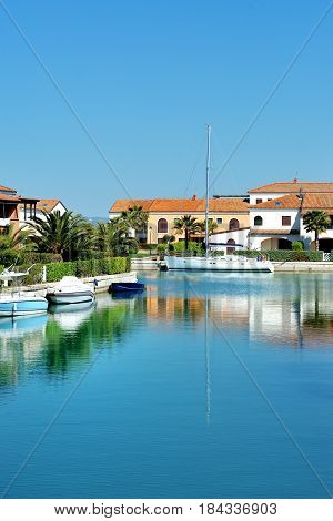 Sea canal boats and houses in Policoro Basilicata Italy