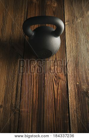 Iron Kettlebell On Wooden Background Sport Equipment Background With Copyspace