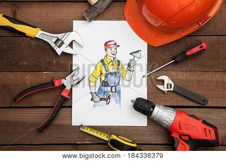 Picture of a builder with various building implements.