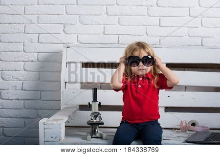 Child In Sunglasses Or Small Boy With Laptop And Headphones