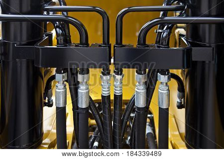 Hydraulic pressure pipes on new construction machinery.