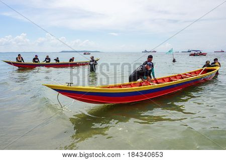 Labuan,Malaysia-April 29,2017:Group of people ready to participate in the boat tug of war games in Labuan International Sea Sports Complex at Labuan,Malaysia on 29th April 2017.