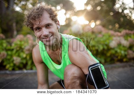 Portrait of happy man listening to music on mobile phone