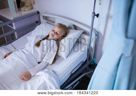 Patient relaxing on bed in ward at hospital