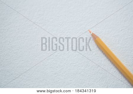 Close-up of peach color pencil on white background