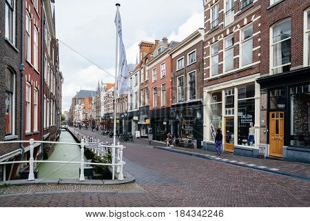 Delft Netherlands - August 3 2016: Cityscape of Delft with picturesque buildings and cobble pavement