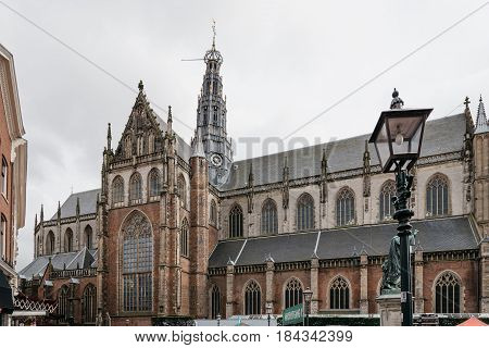 Haarlem Netherlands - August 3 2016: Outdoors view of Cathedral of Haarlem. The Grote Kerk is a Protestant church and former Catholic cathedral located on the central market square.