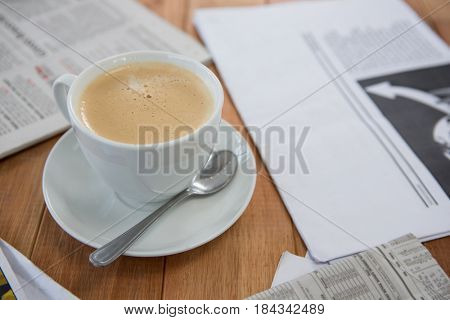 Coffee served on wooden table