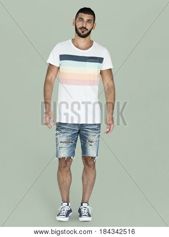 Casual man is standing in a studio shoot