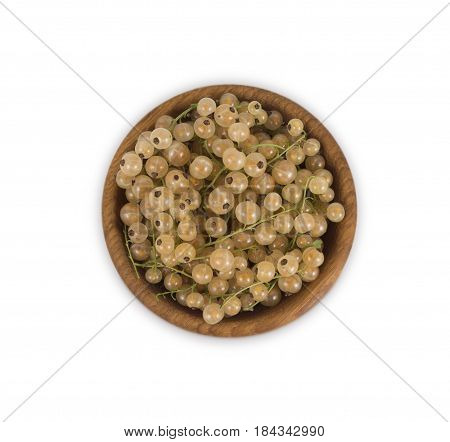 White currants in a wooden bowl. Top view. Ripe and tasty currants isolated on white background.