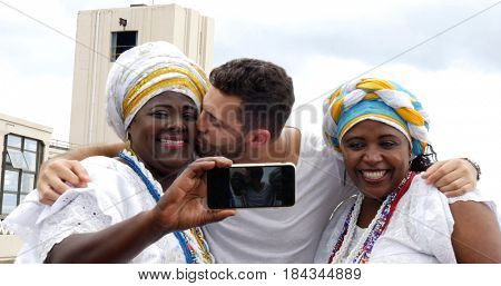 Tourist taking a selfie with tradicional Brazilian Women - Baianas