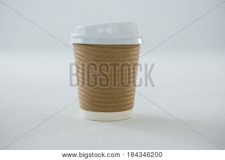 Take away disposable coffee cup on white background