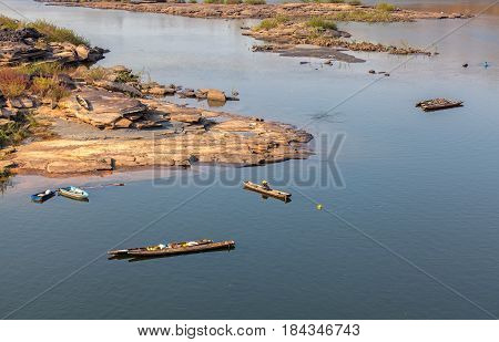Wooden boat at The Pak Mun Dam constructed on the Mun Rivera tributary of the Mekong River in Ubon Ratchathani ProvinceThailand.