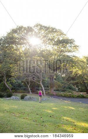 Rear view of female jogger jogging in the park