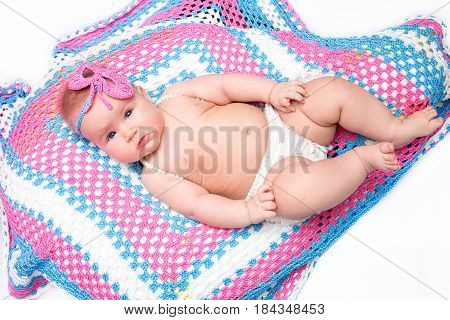 A cute newborn little baby girl. Use it for a child parenting or love concept.