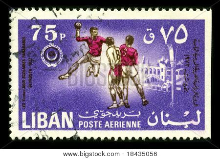 LEBANON-CIRCA 1973:A stamp printed in LEBANON shows image of the Handball is a team sport in which two teams of seven players each pass a ball to throw it into the goal of the other team circa 1973