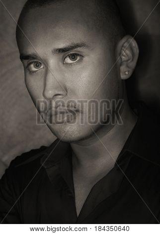 Serious Hispanic man