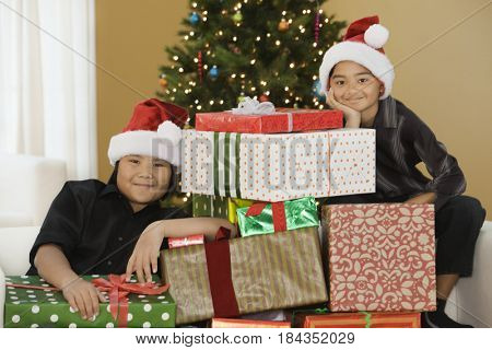 Filipino boys with stack of Christmas gifts