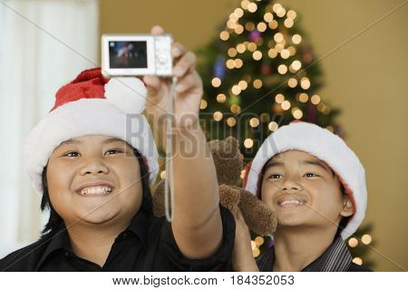 Filipino boys taking self-portrait at Christmas time