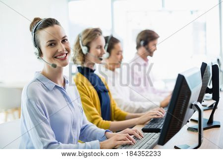 Team of customer service executives working in call center