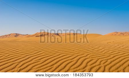 Patterns created by wind and desert sand at the Sahara desert in Morocco