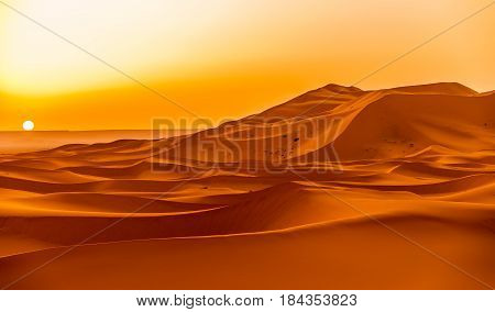 Sunrise over the sand dunes of Erg Chebbi in Sahara - Morocco