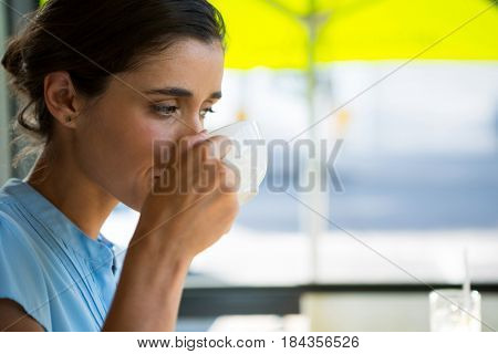 Female executive drinking coffee in café
