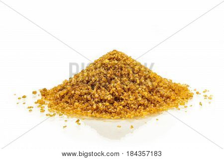 A photo of a mound of brown sugar, on a white background with a place for text