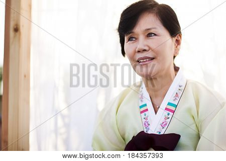 Woman in traditional Asian clothing