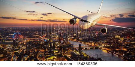 Passengers airplane flying above London city in the sunset light. Transportation and travel, European destination.