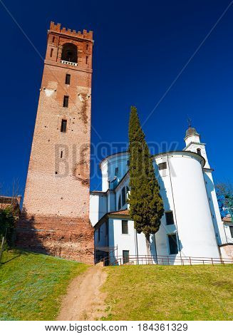 Castelfranco Veneto - February 2017, province of Treviso, Italy: Wide angle view of Catholic church and the old bell tower in Castelfranco, walled town in Northern Italy, sunny day with clear blue sky