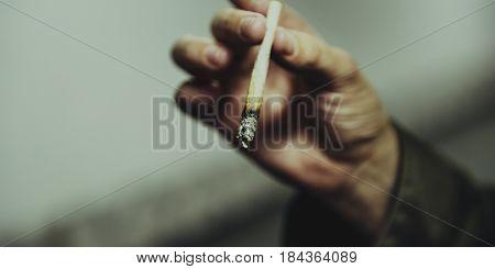 Person hold cigarette to smoke