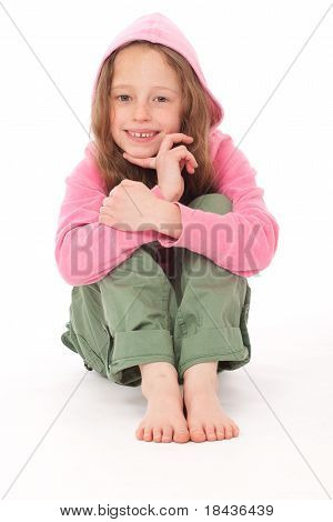 Young Pretty Girl wearing hood sitting on floor Smiling