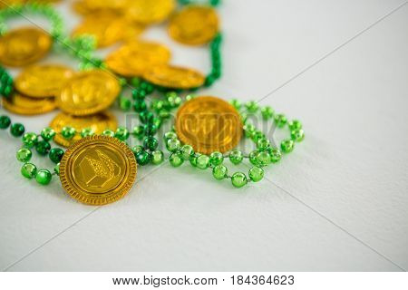 St Patricks Day shamrocks and gold chocolate coin on white background